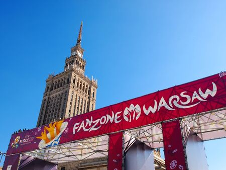 EURO 2012 FANZONE IN WARSAW, POLAND - JUNE 7: Fanzone and Palace of Culture in Warsaw on June 7, 2012. Warsaw will host the opening match of the UEFA Euro 2012.