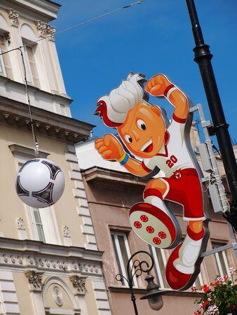 krakowskie przedmiescie: EURO 2012 MASCOT IN WARSAW, POLAND - JUNE 7: Euro 2012 Mascot on Krakowskie Przedmiescie in Warsaw on June 7, 2012. Warsaw will host the opening match of the UEFA Euro 2012. Editorial