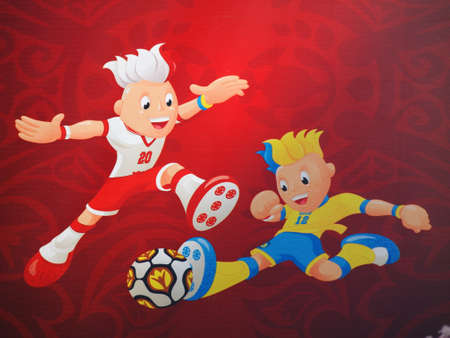 krakowskie przedmiescie: EURO 2012 MASCOTS IN WARSAW, POLAND - JUNE 7: Euro 2012 Mascots on Krakowskie Przedmiescie in Warsaw on June 7, 2012. Warsaw will host the opening match of the UEFA Euro 2012.