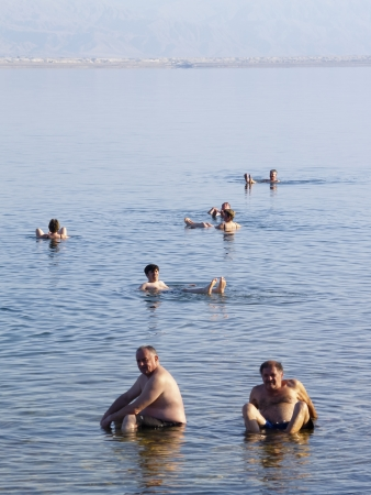 People floating in the Dead Sea, Israel