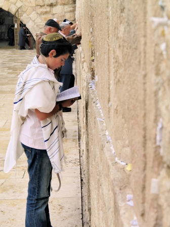 People praying in front of the Wailing Wall, Jerusalem, Israel