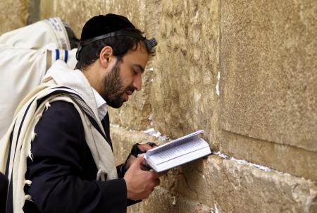 Man praying in front of the Wailing Wall, Jerusalem, Israel