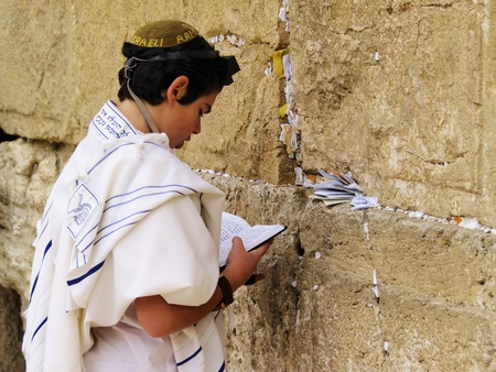 Boy praying in front of the Wailing Wall, Jerusalem, Israel