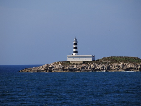 Lighthouse on Isla de Es Penjats, near Ibiza, Balearic Islands, Spain photo