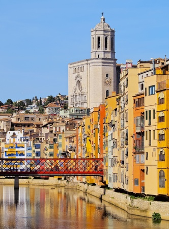 Colorful houses and the cathedral of Girona reflecting in the Onyar River. photo