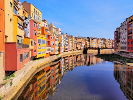 Colorful houses of Girona reflecting in the Onyar River.
