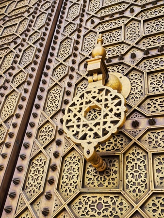 Beautifully decorated Moroccan Doors of the Hassan Mosque in Rabat, Morocco, Africa photo