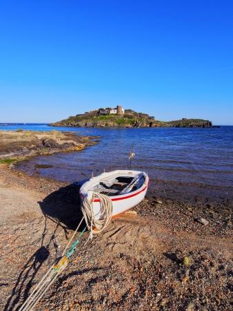 Boat in a bay of Cap de Creus Peninsula, Costa Brava, Catalonia, Spain photo