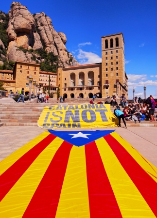 MONTSERRAT, SPAIN - APRIL 21: Unidentified young people manifesting independence of Catalonia in front of the Santa Maria de Montserrat Abbey on April 21, 2013 in Montserrat, Spain.