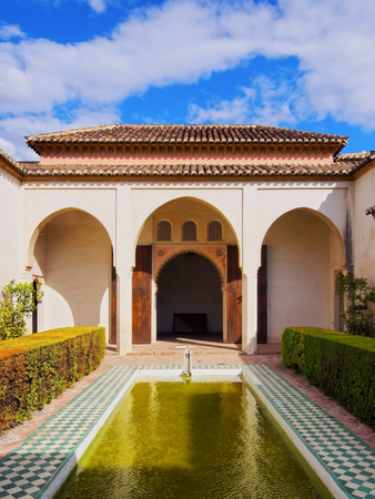 Courtyard garden of the Cuartos de Granada in the Alcazaba - old fortification in Malaga, Andalusia, Spain