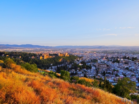 Cityscape of Granada with a view of famous Alhambra - a palace and fortress complex, Andalusia, Spain photo
