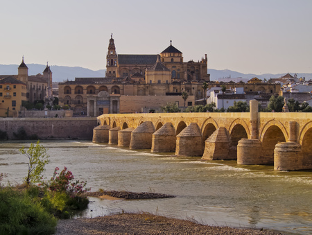 Mezquita-Catedral and Puente Romano - Mosque-Cathedral and the Roman Bridge in Cordoba, Andalusia, Spain photo