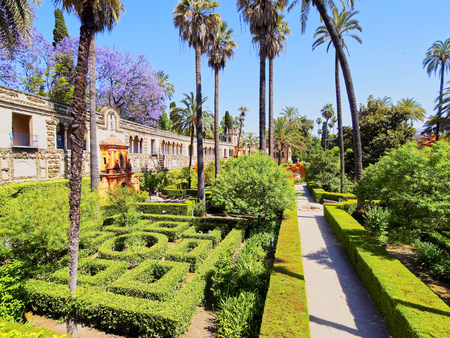 real renaissance: Gardens in Reales Alcazares in Seville - residence developed from a former Moorish Palace in Andalusia, Spain