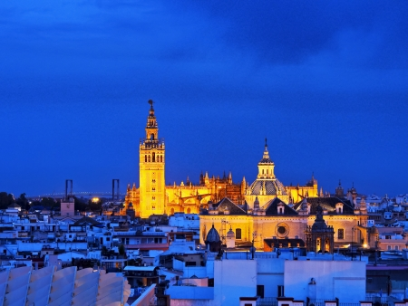 Cityscape of Seville with Santa Maria de la Sede Cathedral, Andalusia, Spain photo