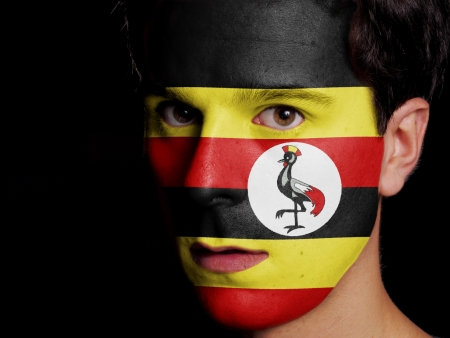 Flag of Uganda Painted on a Face of a Young Man