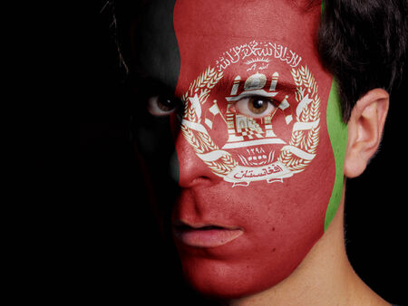 afghan flag: Flag of Afghanistan Painted on a Face of a Young Man