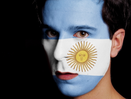Flag of Argentina Painted on a Face of a Young Man photo