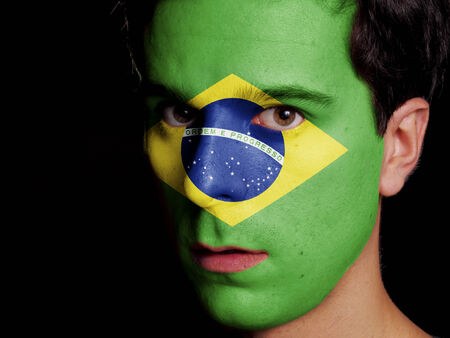 Flag of Brazil Painted on a Face of a Young Man photo