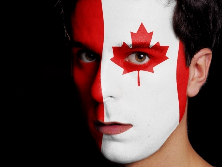 Flag of Canada Painted on a Face of a Young Man photo
