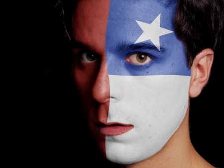 Flag of Chile Painted on a Face of a Young Man photo