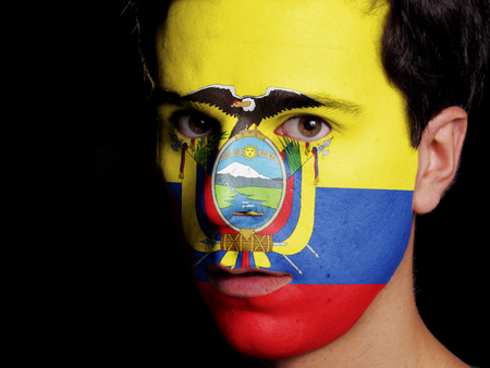 Flag of Ecuador Painted on a Face of a Young Man photo