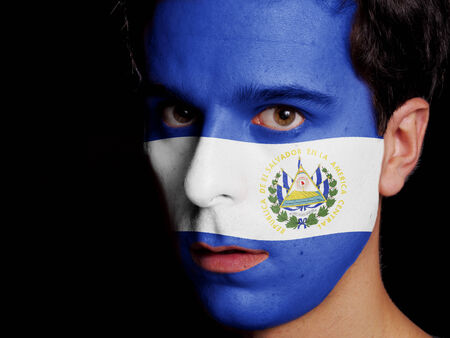 Flag of El Salvador Painted on a Face of a Young Man photo