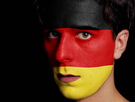 Flag of Germany Painted on a Face of a Young Man photo