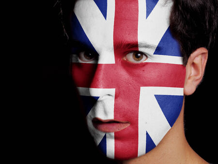 Flag of Great Britain Painted on a Face of a Young Man photo