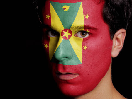 Flag of Grenada Painted on a Face of a Young Man photo
