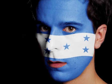 Flag of Honduras Painted on a Face of a Young Man photo