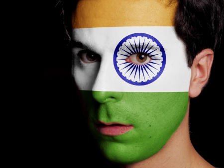 india people: Flag of India Painted on a Face of a Young Man
