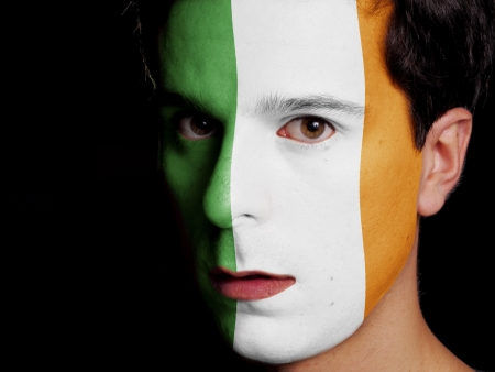 Flag of Ireland Painted on a Face of a Young Man photo