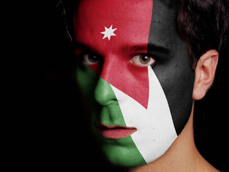 the hashemite kingdom of jordan: Flag of Jordan Painted on a Face of a Young Man