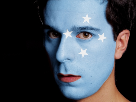 federated: Flag of Micronesia Painted on a Face of a Young Man