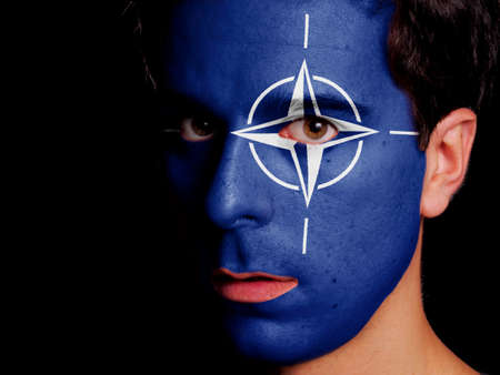 north atlantic treaty organization: Flag of NATO Painted on a Face of a Young Man Editorial