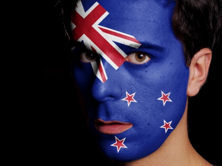 Flag of New Zealand Painted on a Face of a Young Man photo