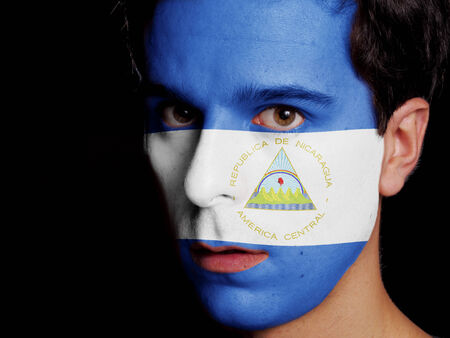 Flag of Nicaragua Painted on a Face of a Young Man photo