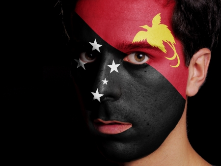 Flag of Papua New Guinea Painted on a Face of a Young Man Stock Photo