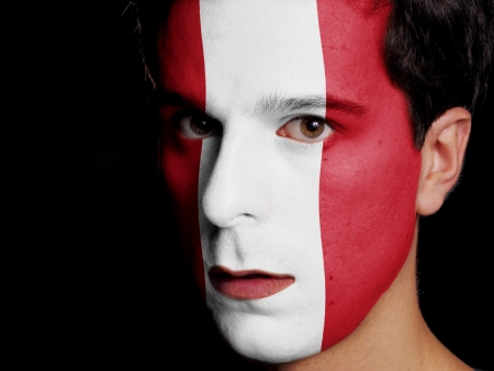 republic of peru: Flag of Peru Painted on a Face of a Young Man Stock Photo