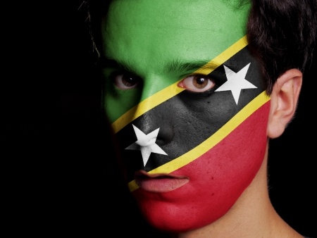 Flag of Saint Kitts and Nevis Painted on a Face of a Young Man photo