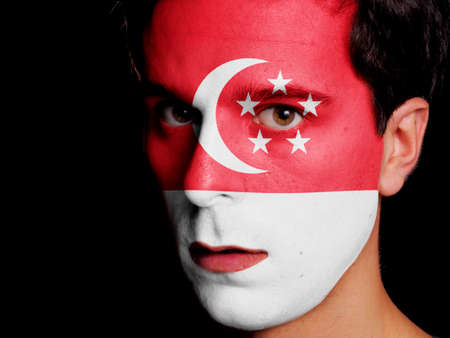 singaporean flag: Flag of Singapore Painted on a Face of a Young Man
