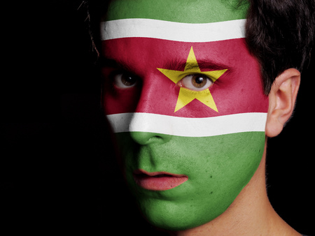 Flag of Suriname Painted on a Face of a Young Man photo