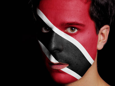 Flag of Trinidad and Tobago Painted on a Face of a Young Man photo