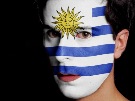 Flag of Uruguay Painted on a Face of a Young Man photo