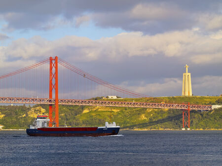 25 de Abril Bridge over the Tagus River in Lisbon, Portugal photo