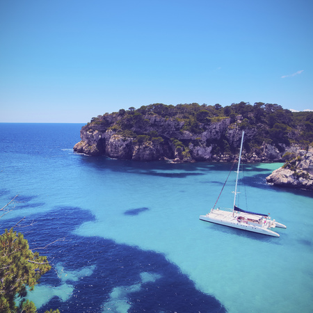Catamaran in Cala Macarella on Menorca, Balearic Islands, Spain photo