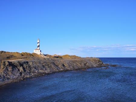 promontory: Lighthouse on Cap Fevartix on Menorca, Balearic Islands, Spain