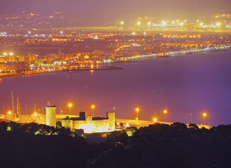 Night aerial view of Castell de Bellver and Palma de Mallorca, Balearic Islands, Spain photo