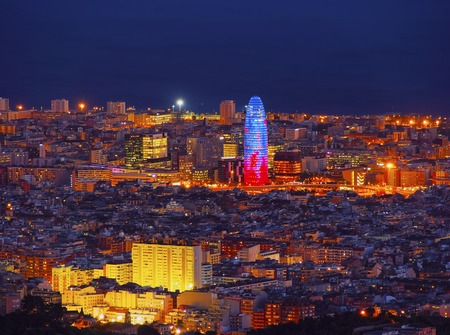 Night view of Torre Agbar designed by famous architect Jean Nouvel in Barcelona, Catalonia, Spain
