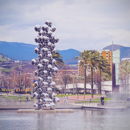 anish: Sculpture The Big Tree consisting of 80 stainless steel balls with reflections by Anish Kapoor in front of The Guggenheim Museum in Bilbao, Biscay, Basque Country, Spain